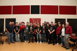 Photo of students and board members