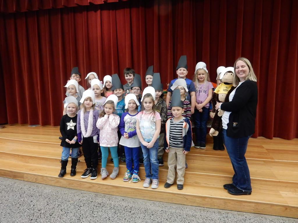 Ms. Ogle's Kindergarten class, dressed as Pilgrims, standing on the stage.