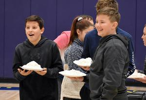 Student at Mars Area Middle School prepare to toss a pie in the faces of teachers Amanda Stavish and Mary Jo Phillips.