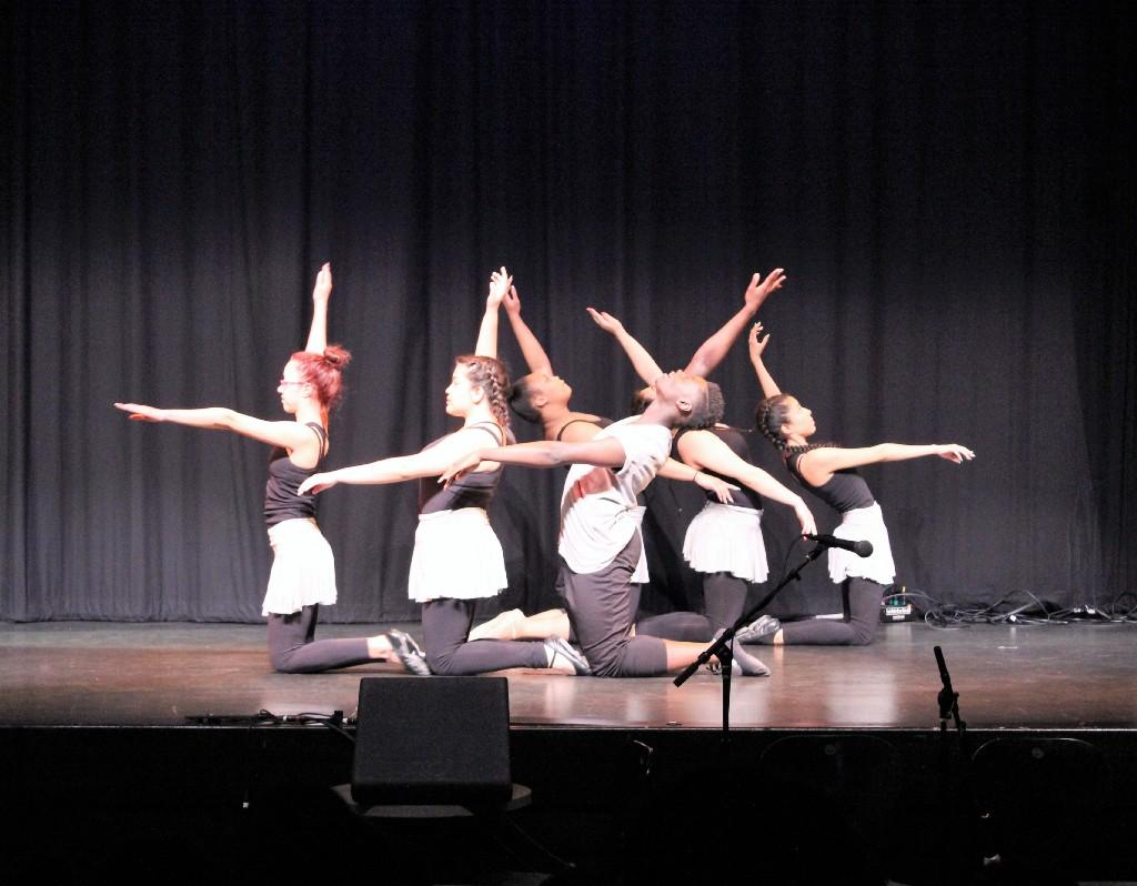 6 dancers posed on stage