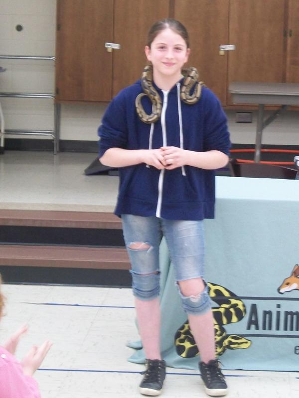 Student wears Ball Python around her neck.