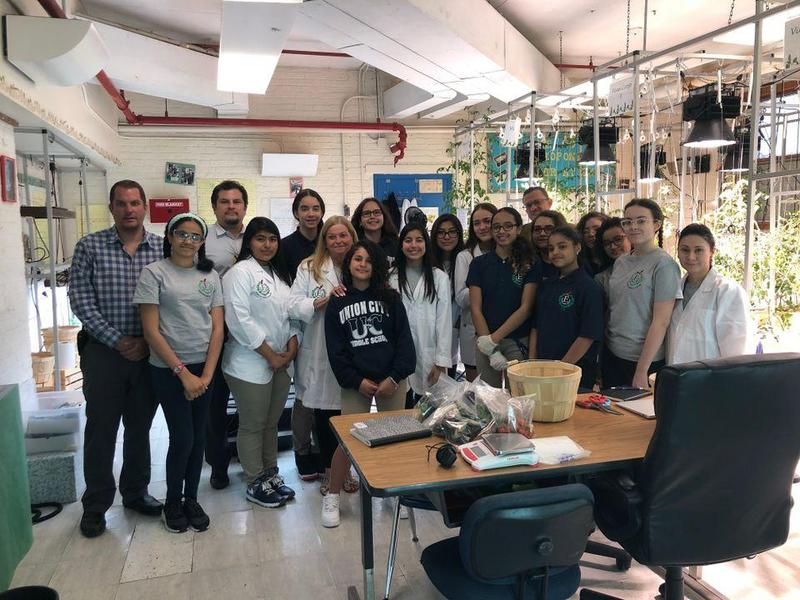 hydroponics labs group proudly showing off their lab