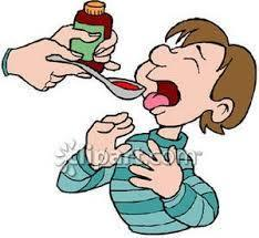 child receiving a spoonful of medicine