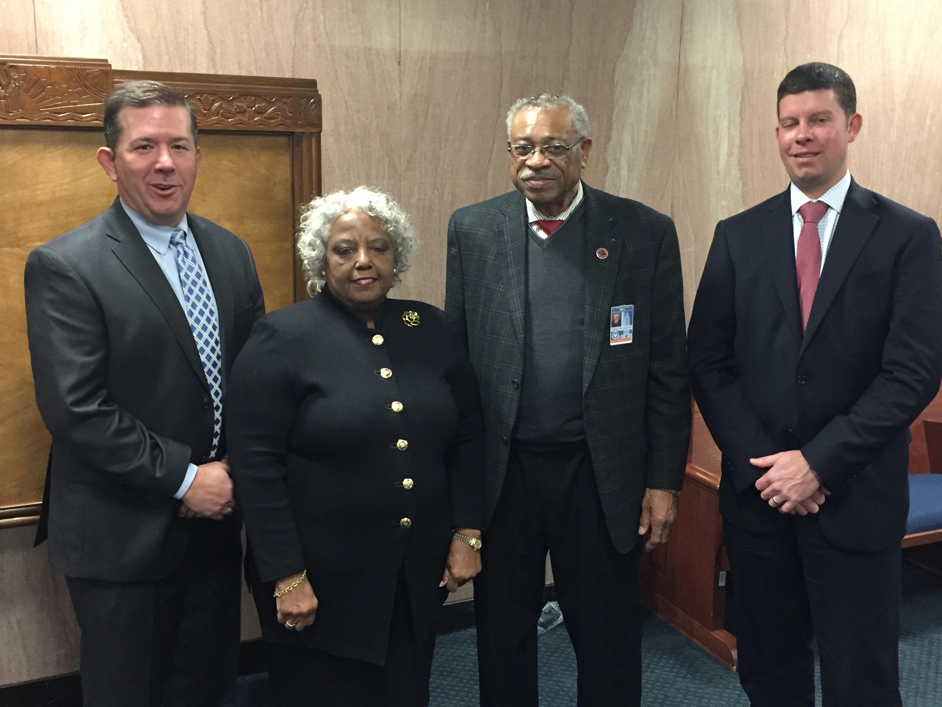 A photo of the City of Baker School board president, Dr. Dana Carpenter and vice president Mrs. Elaine G. Davis with members of the Louisiana State Bond Commission