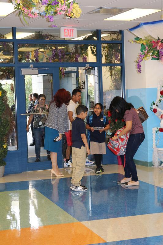 Principal Diaz welcoming families at the entryway