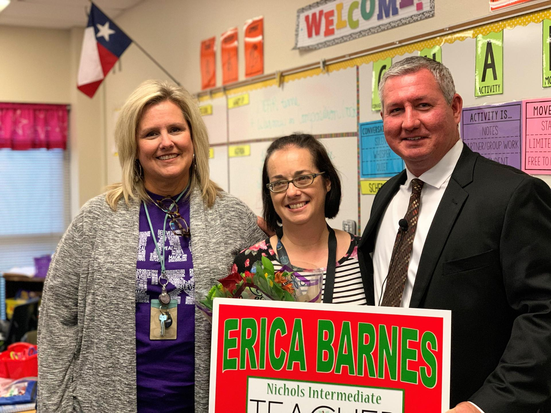erica barnes with principal and superintendent