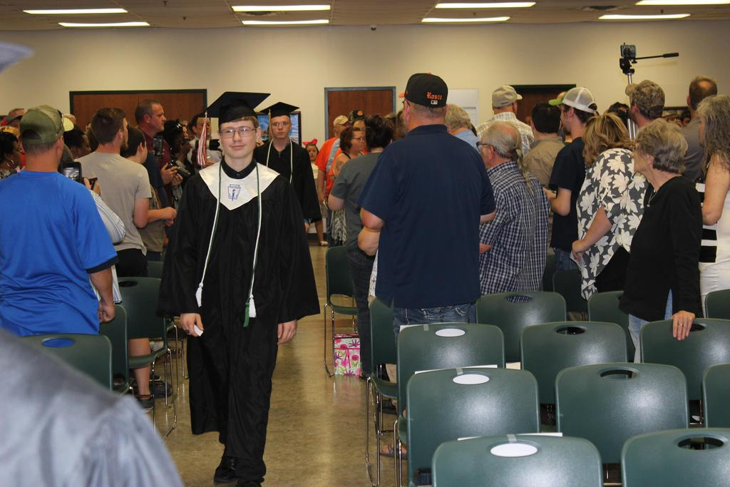 Graduating Student Marching down aisle