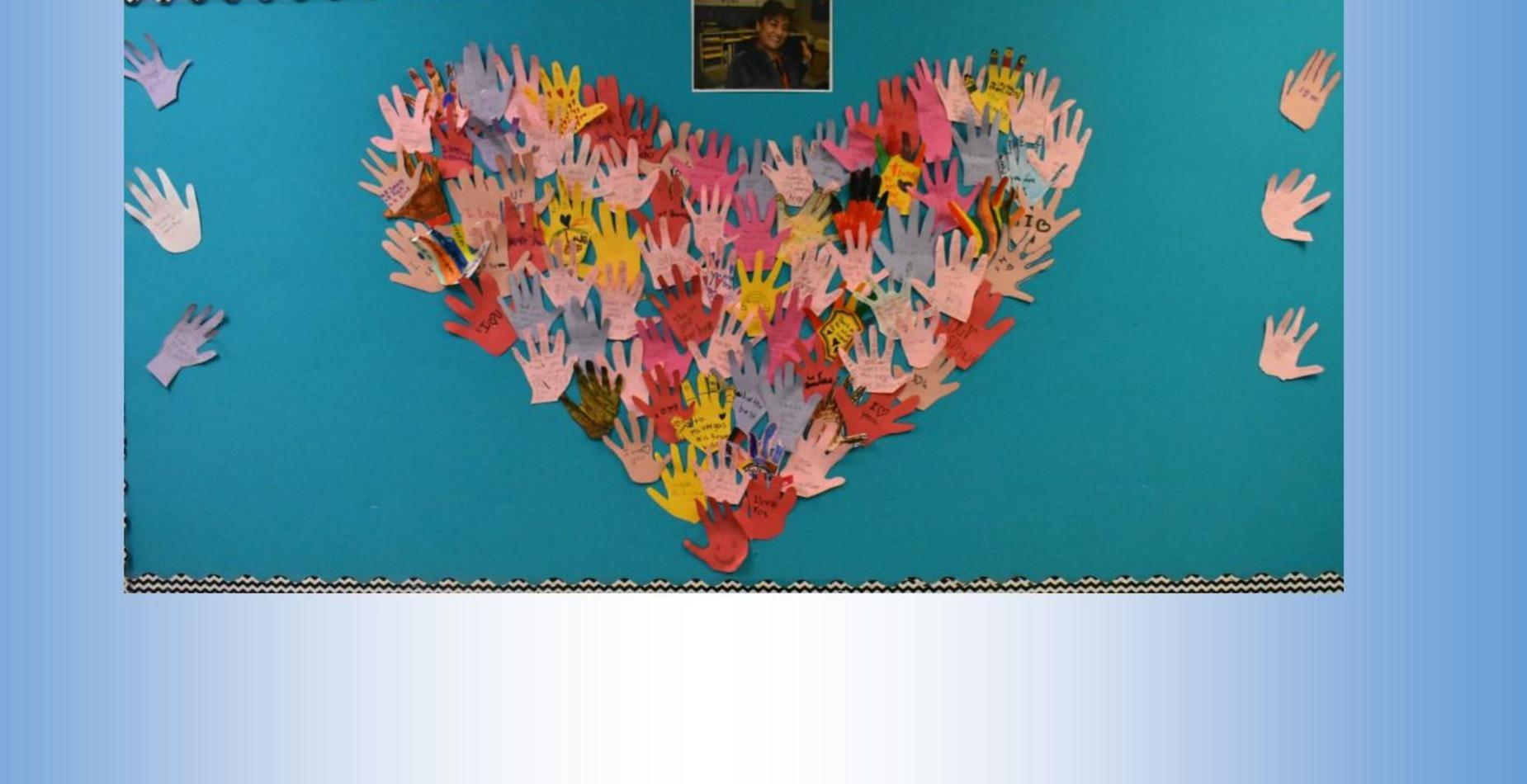 A heart made out of cut out hand prints.  Each hand has a thank you note written on it.