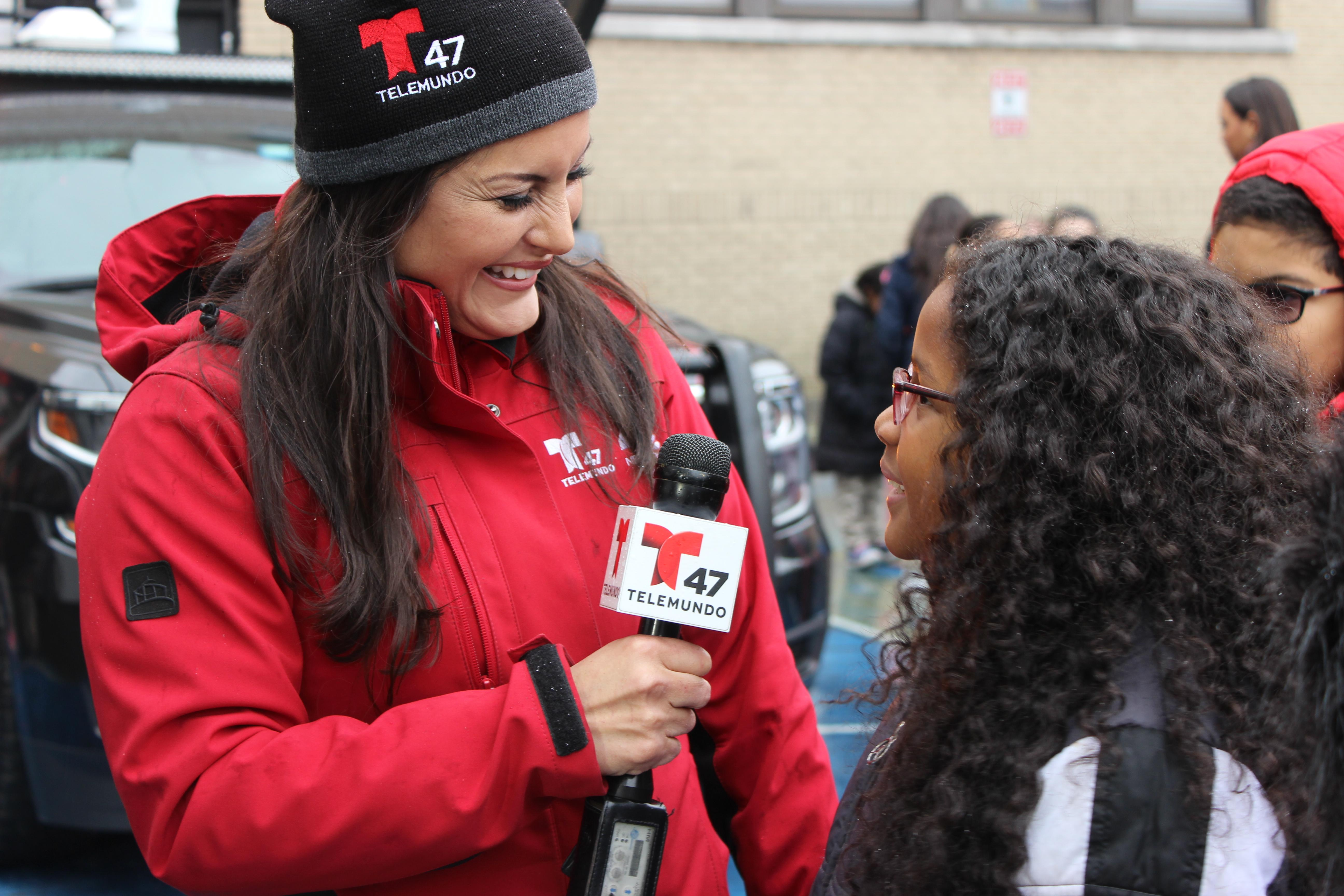 roosevelt female student being interviewed by weather woman