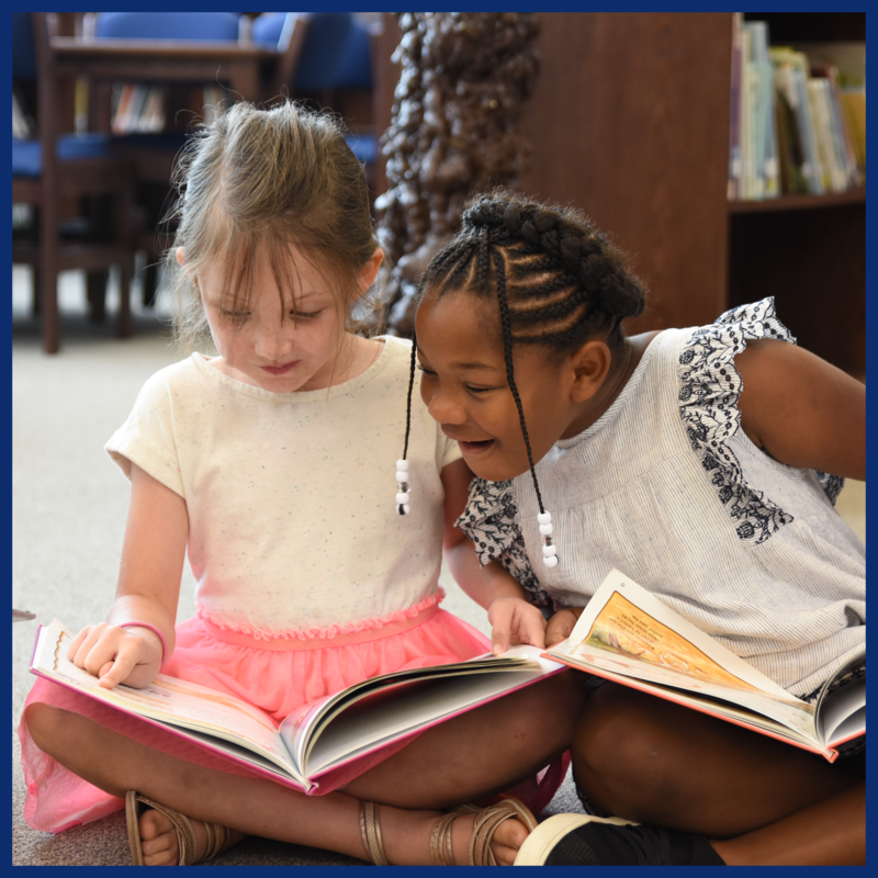 kindergarten girls reading in library