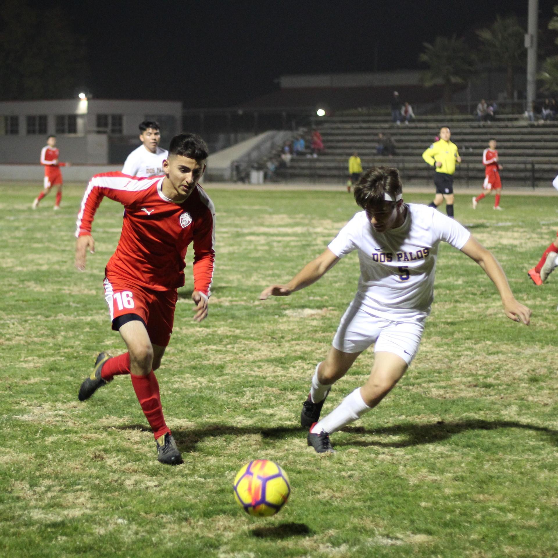 Christian Fernandez running towards the ball