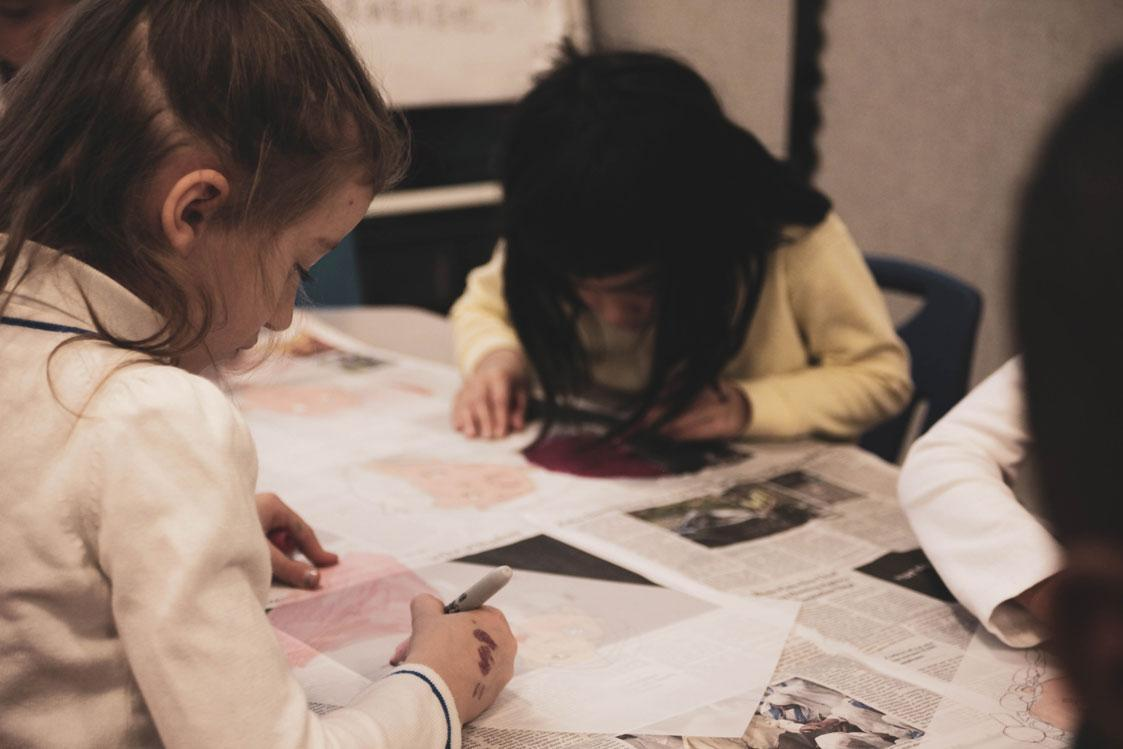Students work on a self portrait project at HudsonWay Immersion School
