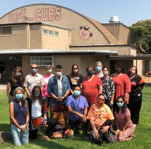 Image of the OVUSD staff wearing masks in front of the gymnasium