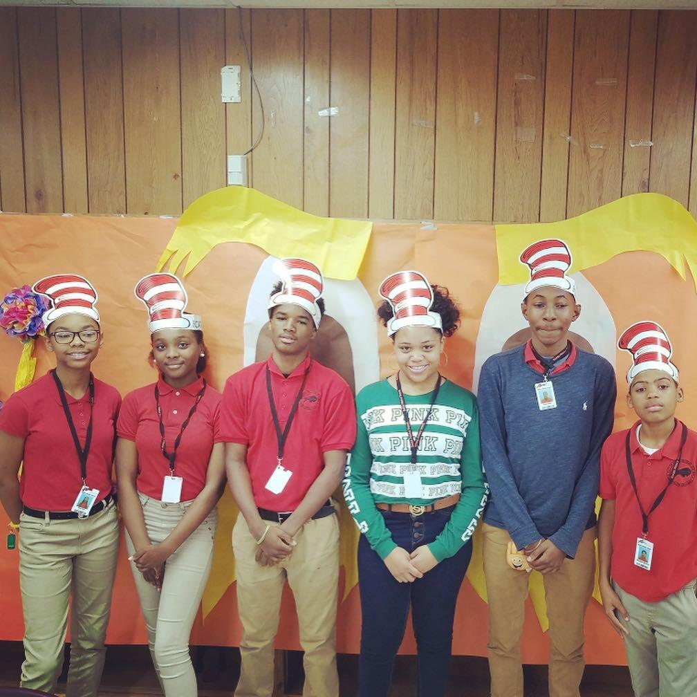 photo related to Baker Middle JAGs in community service reading books to students at Baker Heights