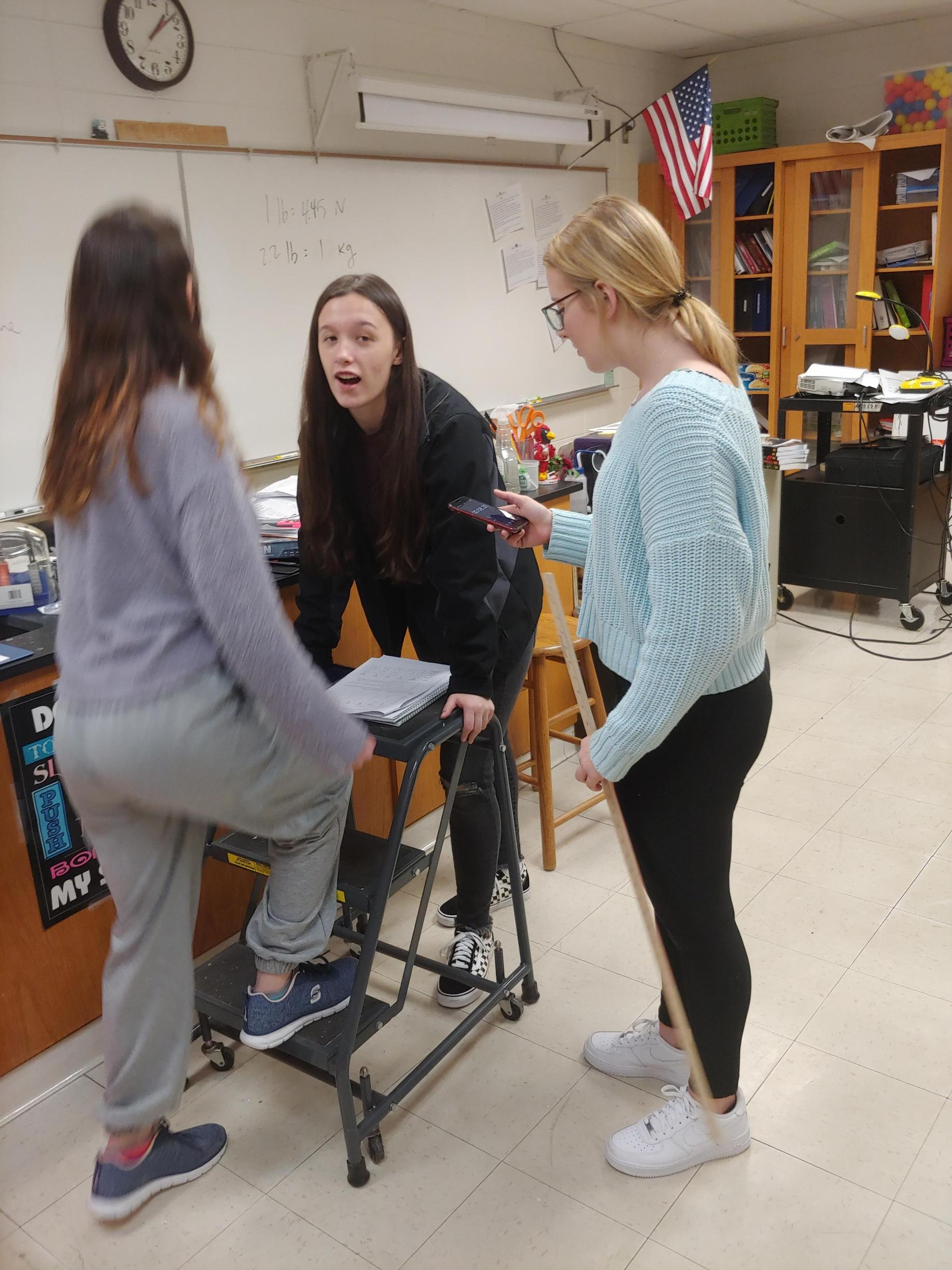 Physics students exploring power and energy.