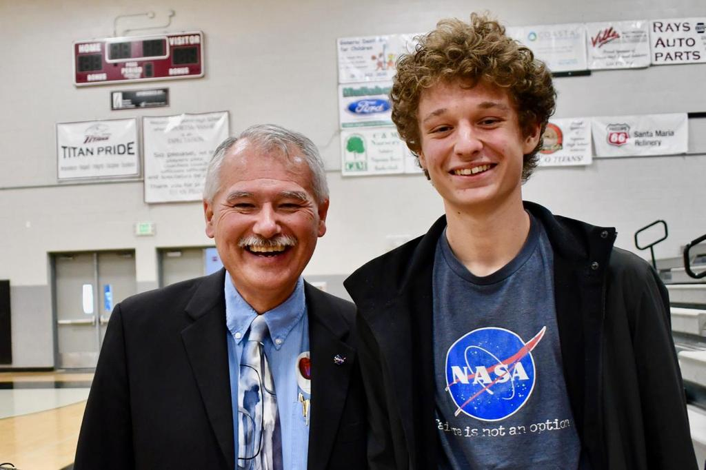 Student with Albion Bowers, Chief NASA Scientist