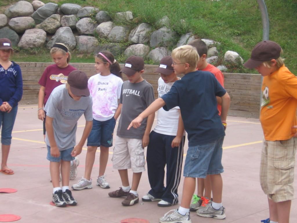 kids point to ground at camp