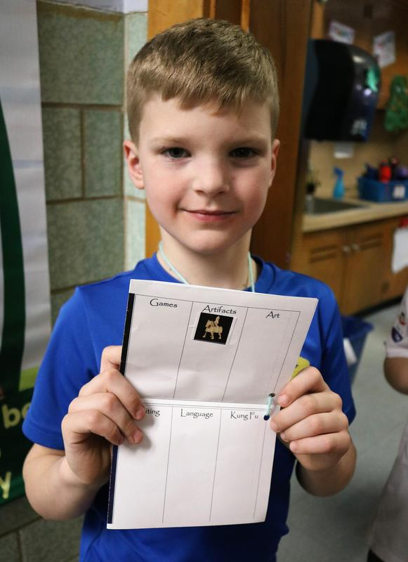 Photo of a Franklin School 2nd graders showing his