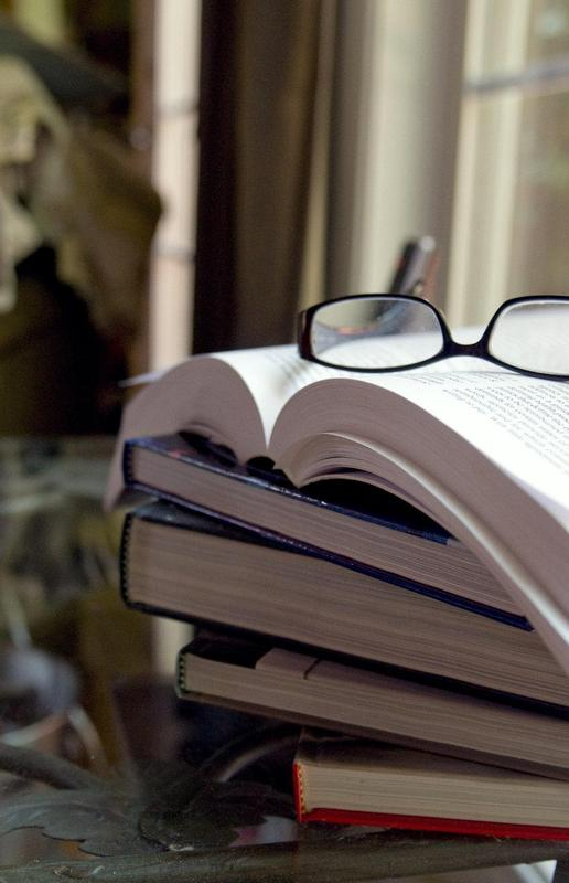 15975-a-pair-of-glasses-with-a-stack-of-books-pv.jpg