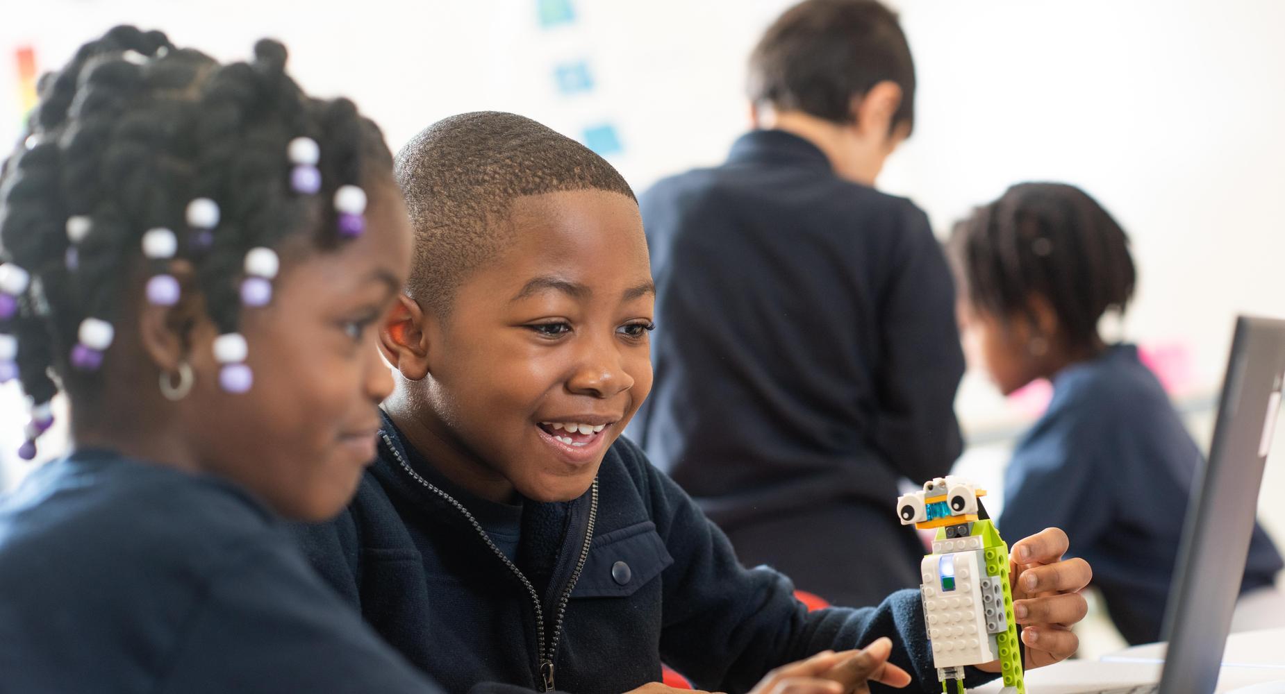 Early Childhood students doing Lego robotics