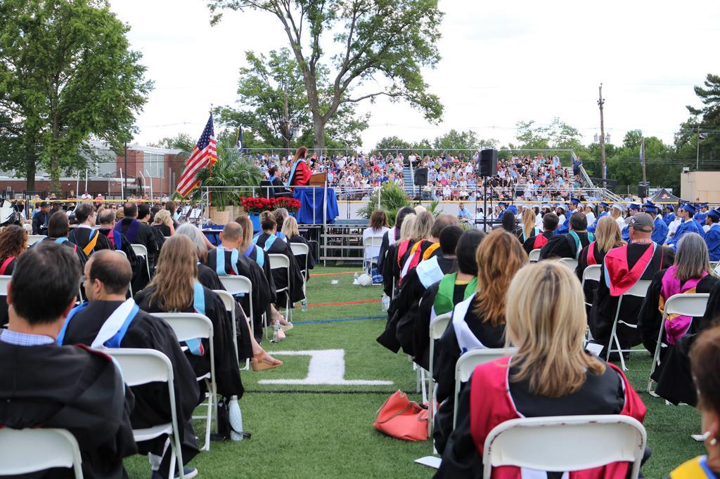 Photo of Superintendent Dr. Margaret Dolan addressing graduates