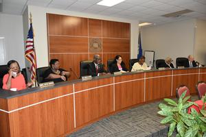 a photo of the City of Baker School Board members seated for meeting