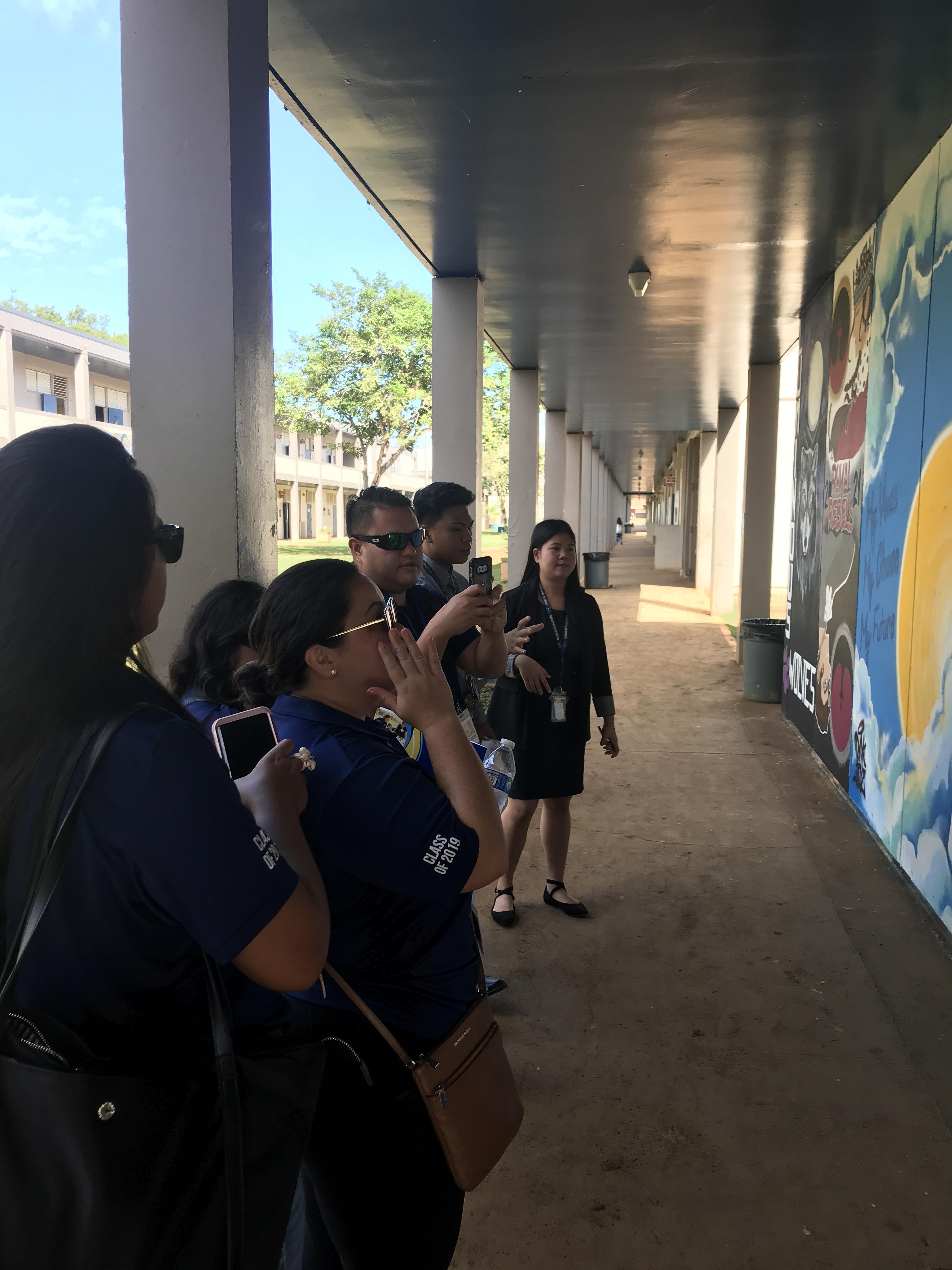 PCF members from the Mariana Islands look at the Class Murals