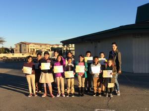 Students of the month holding their certificates