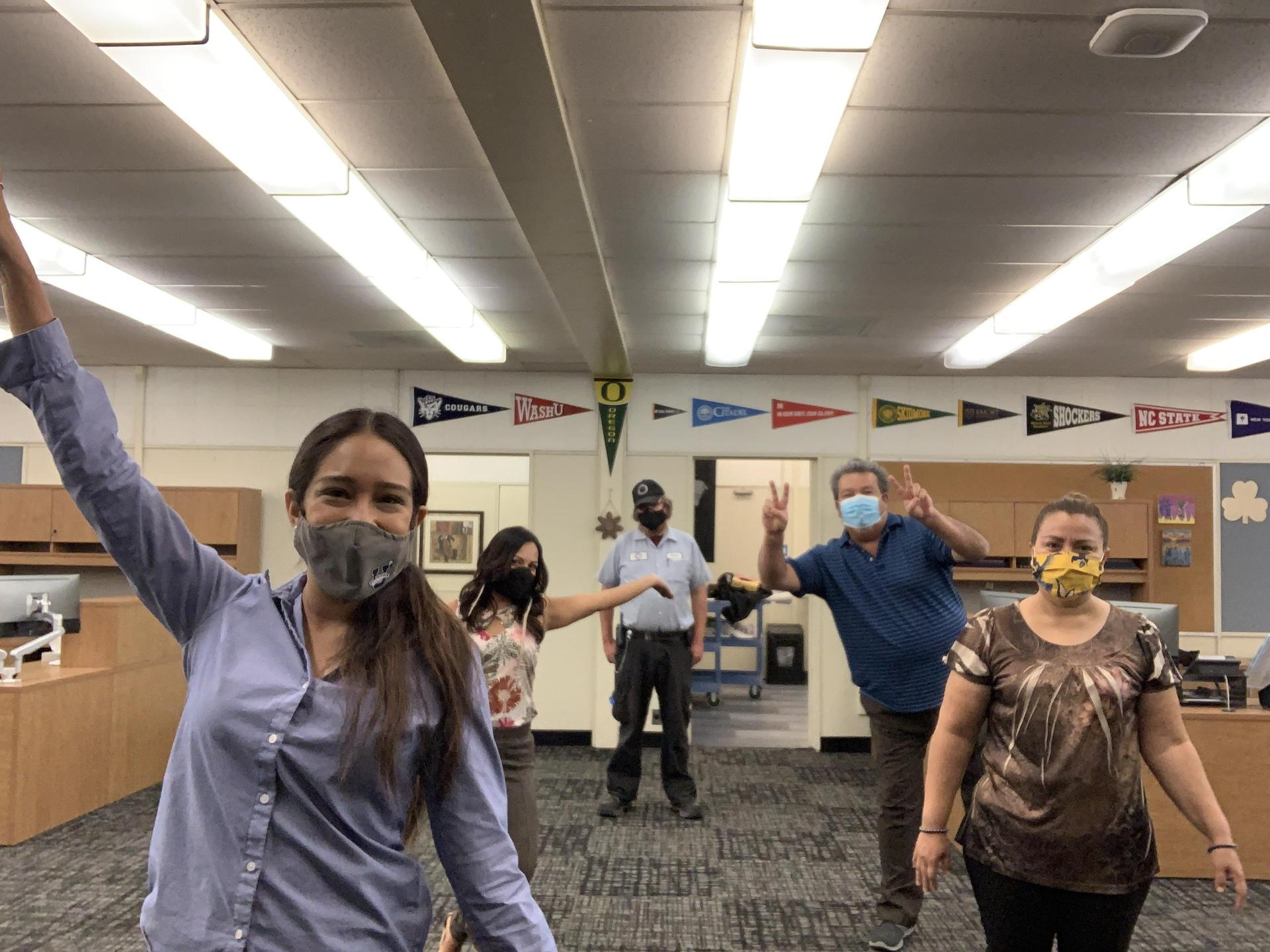 Picture of the Parent Resource Center Staff practing social distancing and wearing face masks.