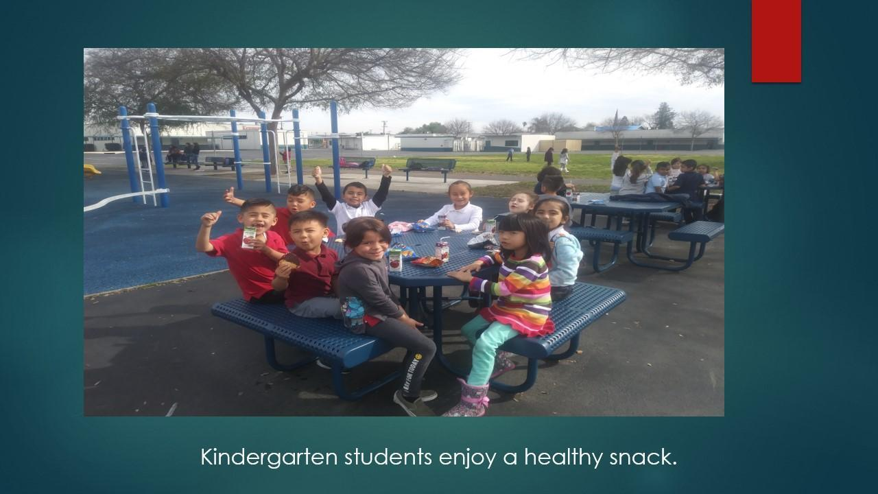 Kinder students outside for lunch.