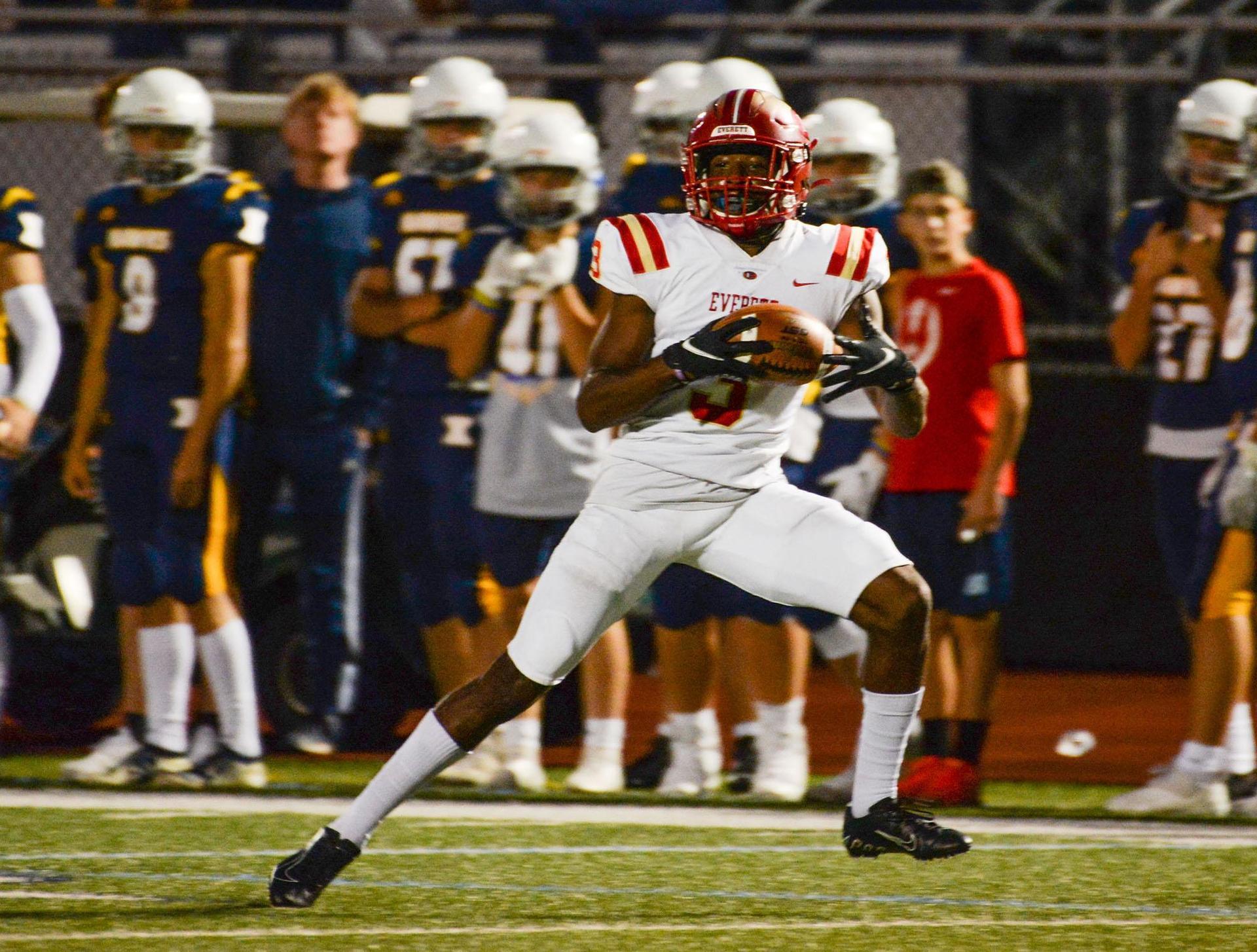 An EHS player running into the open field