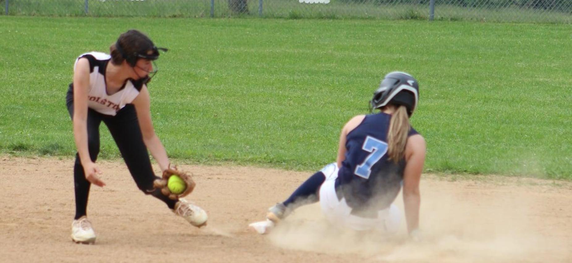 A softball player tags a runner.