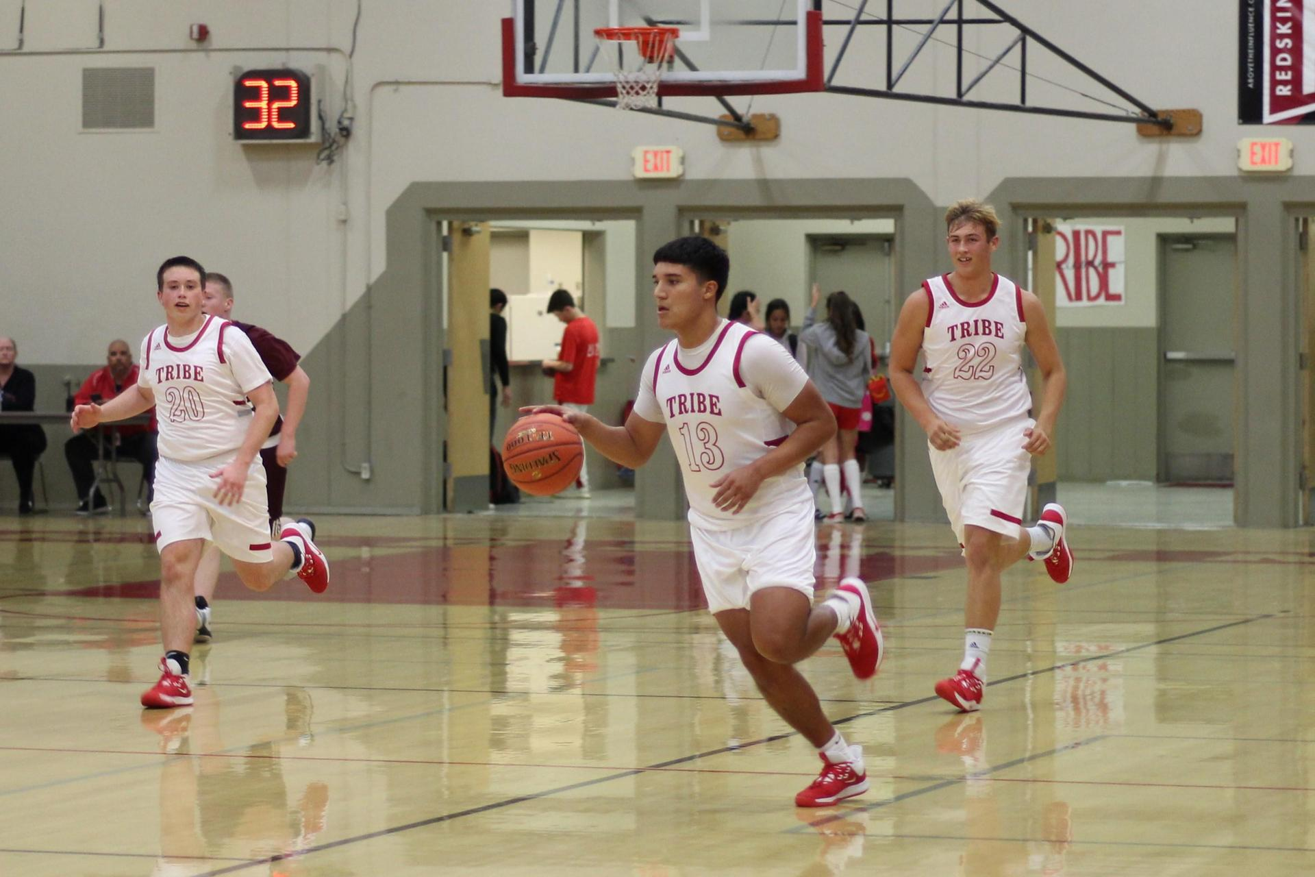 varsity boys playing basketball against Kings Christian