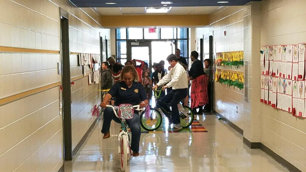 Administrators riding prize bikes
