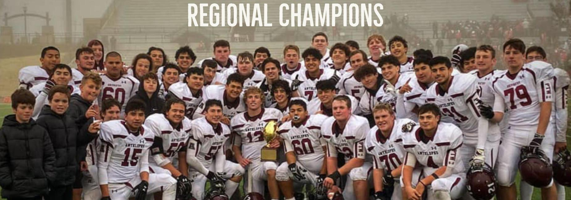 High School football team pose with trophy