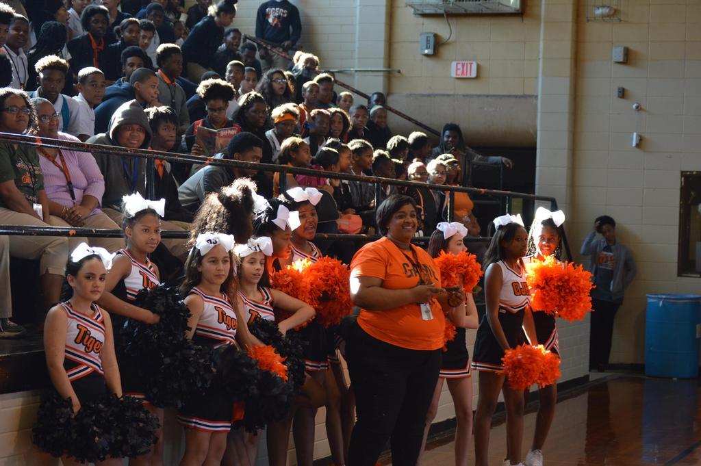 Ms. Jean and cheerleaders