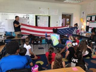 Mr. Mitchell teaching us how to fold the flag.