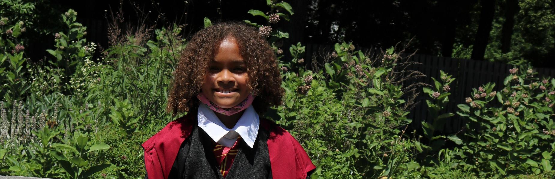 Photo of Franklin 3rd grader dressed as Hermine from Harry Potter during Living Wax Museum.