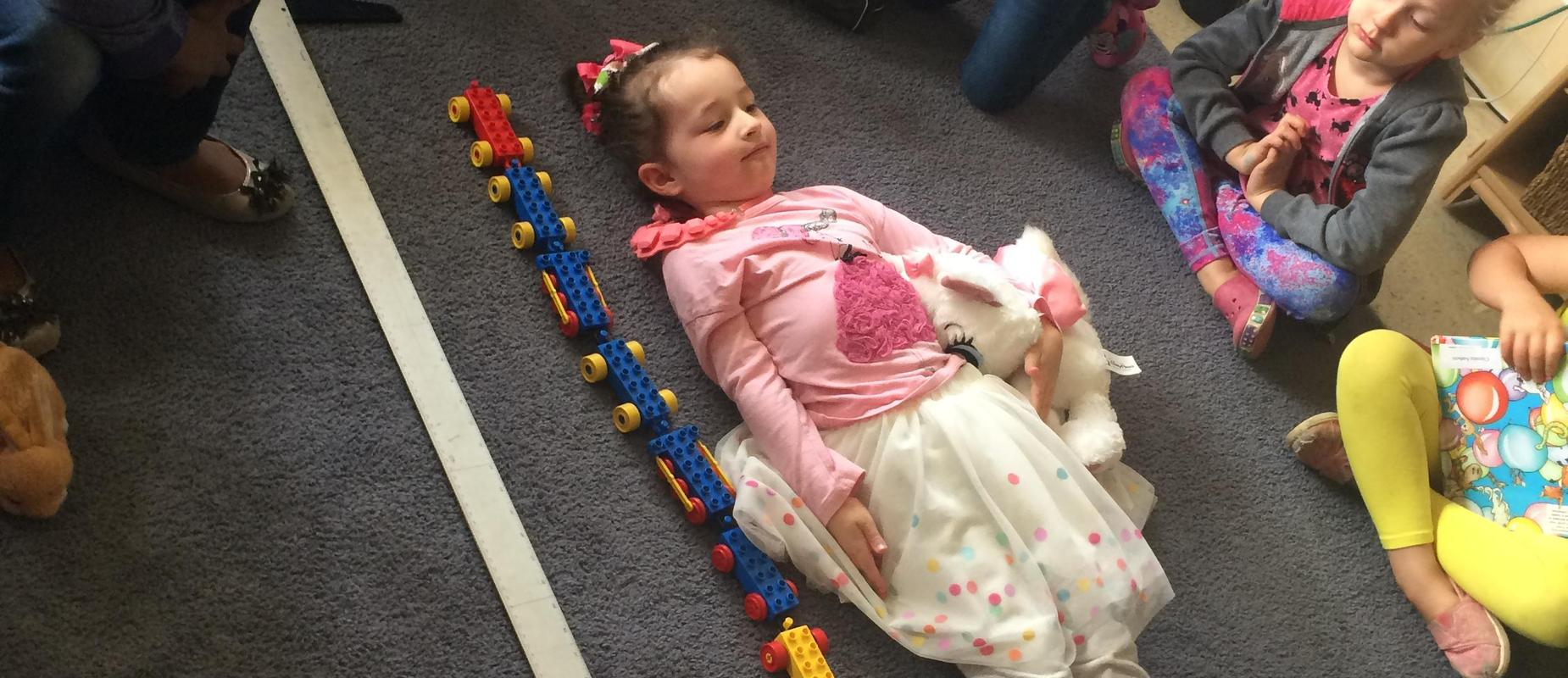 girl being measured with blocks