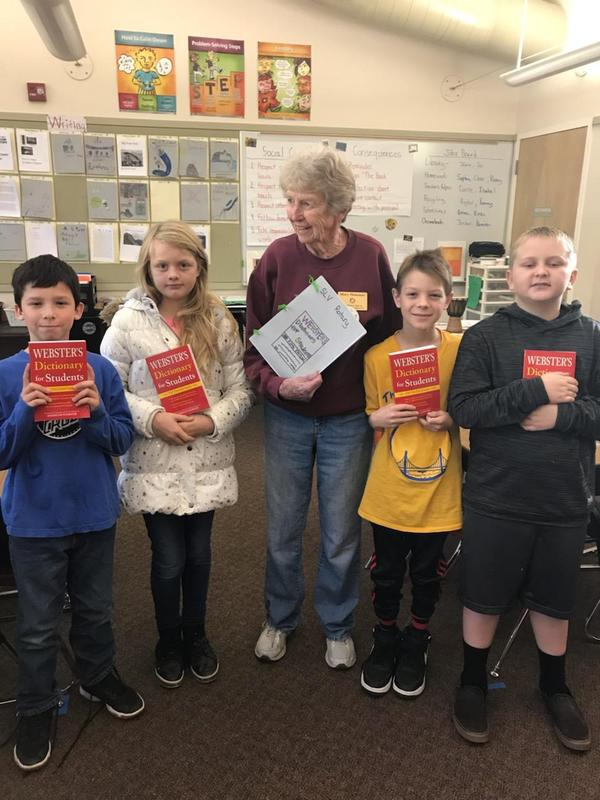 Students Receiving Dictionaries from Rotary