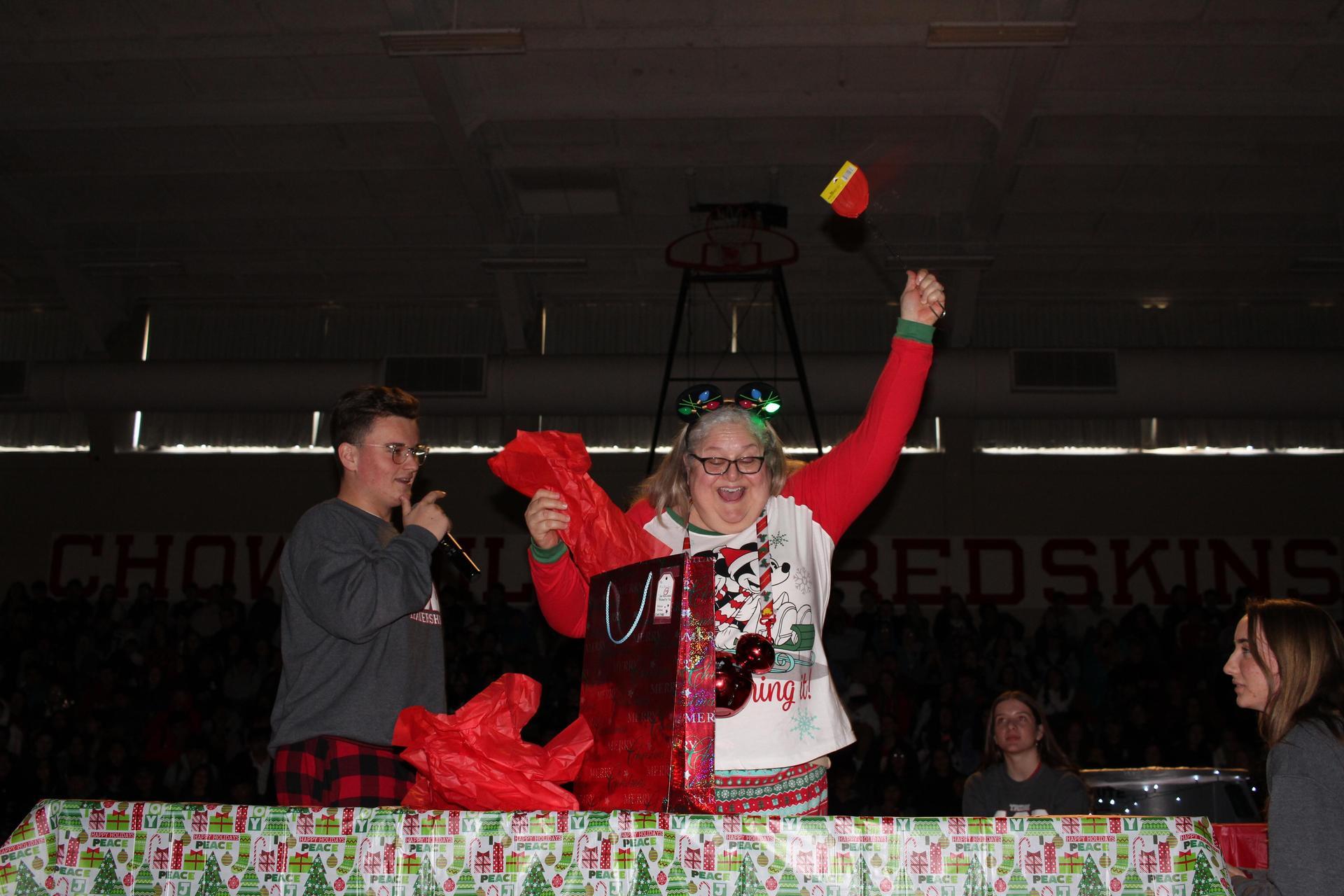 Ms. Freitas opening her gift