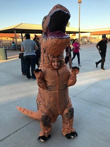 Student dressed like a T-Rex.