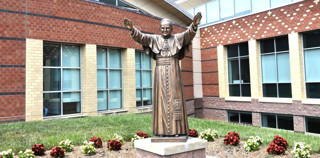 Statue of John Paul II outside the school