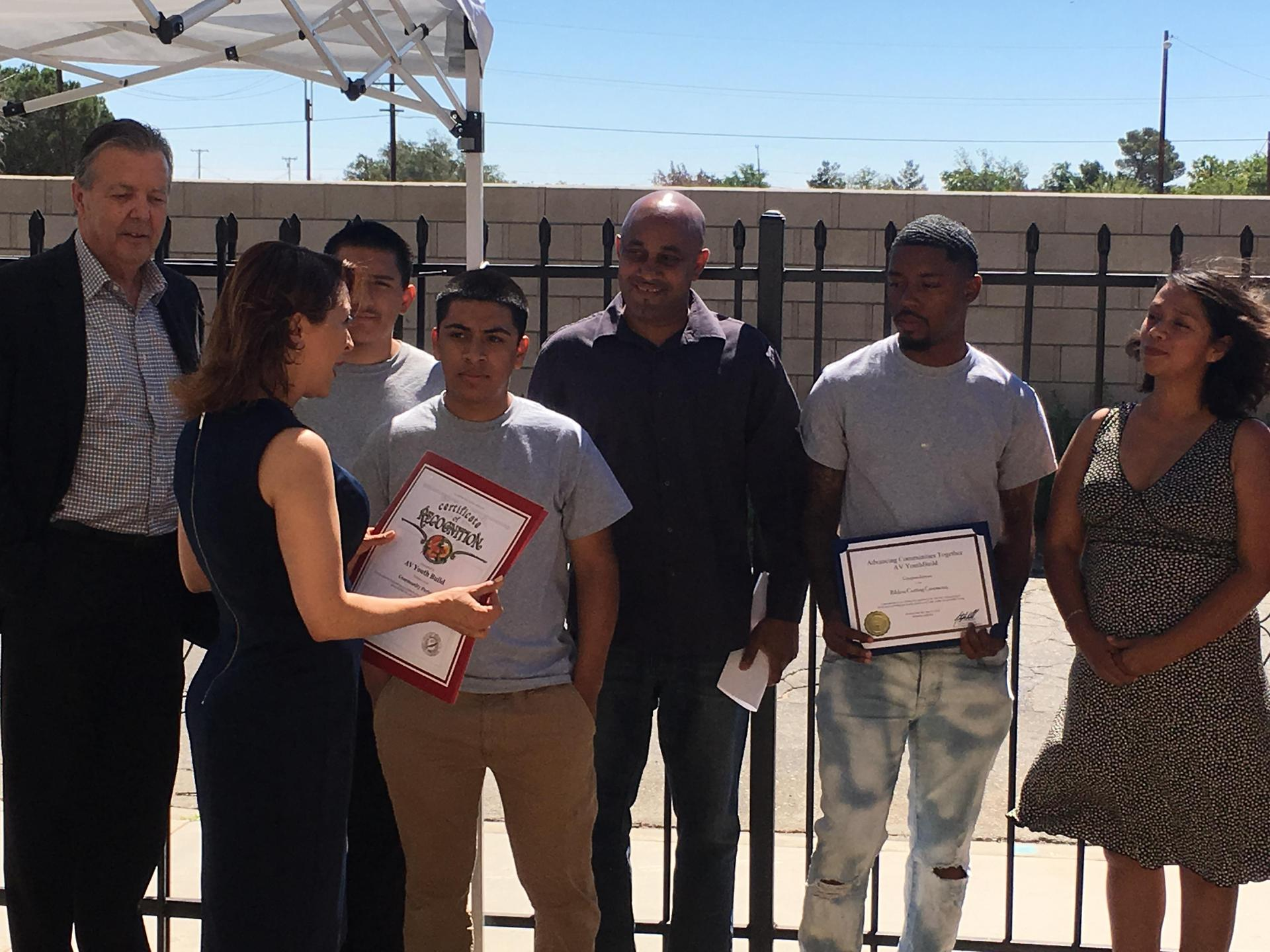 AVYB students and staff receiving a certificate of appreciation