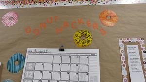 A bulletin board announces the Donut Hackers meeting.