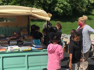 students getting donated books
