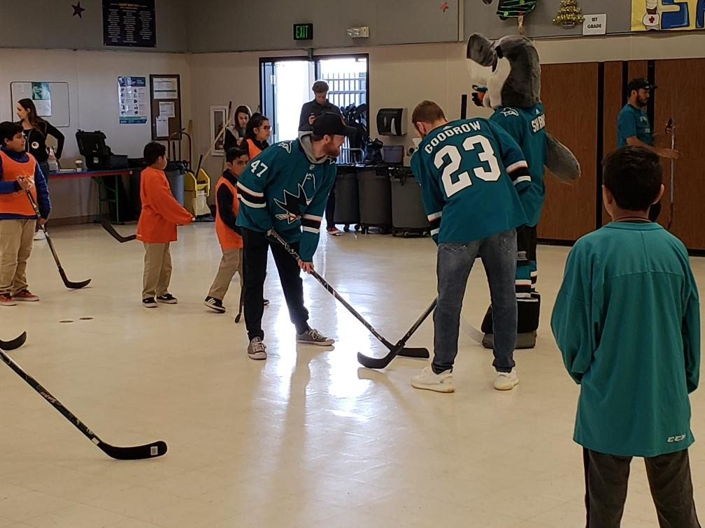 sharks players go head to head in game of ball hockey