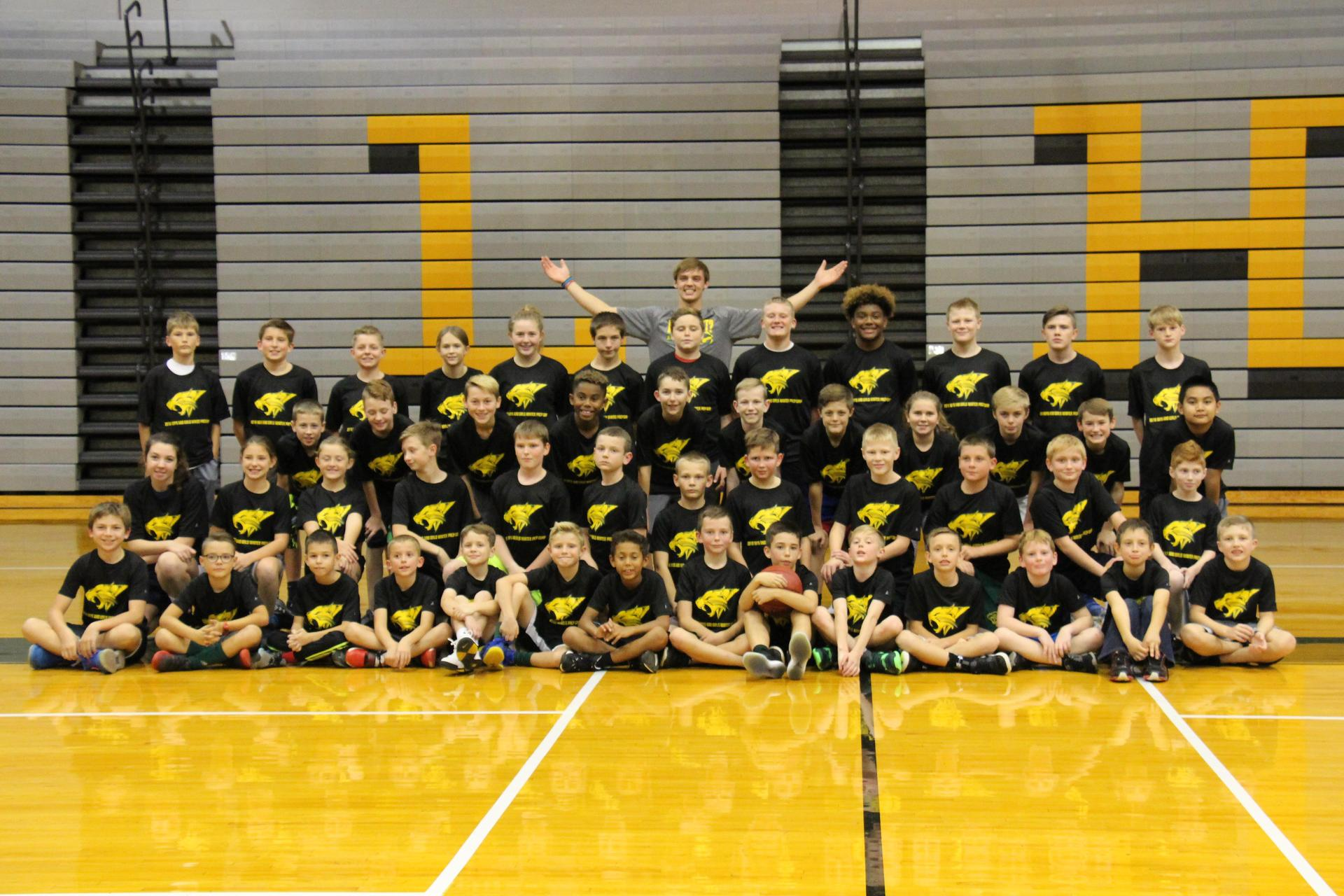 Students posing for group basketball camp photo