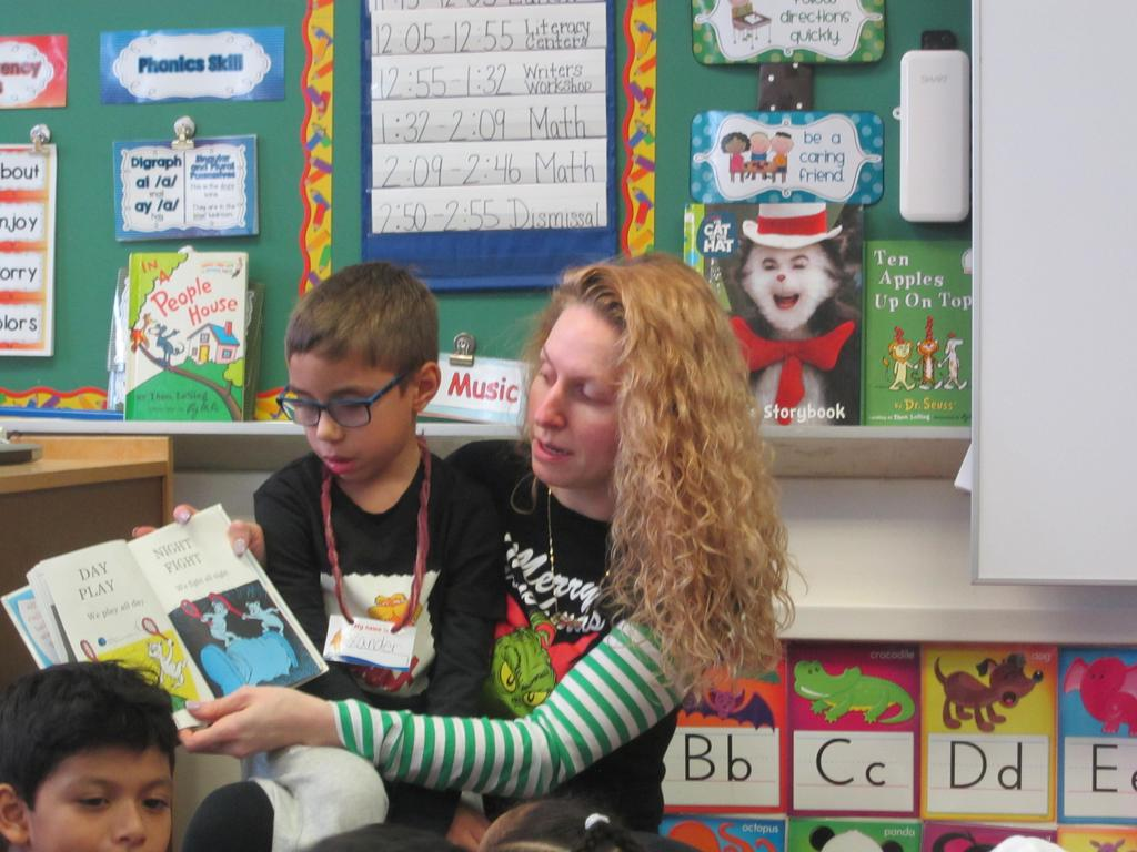mom with son on her lap reading to the class close up
