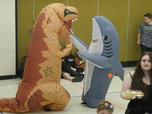 Dinosaur and shark costumes in the gym.
